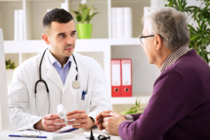 Doctor consulting patient with Alzheimer's Disease